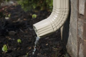 downspout draining too close to the house